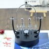 Couple Newton Cradle Swing - Silver
